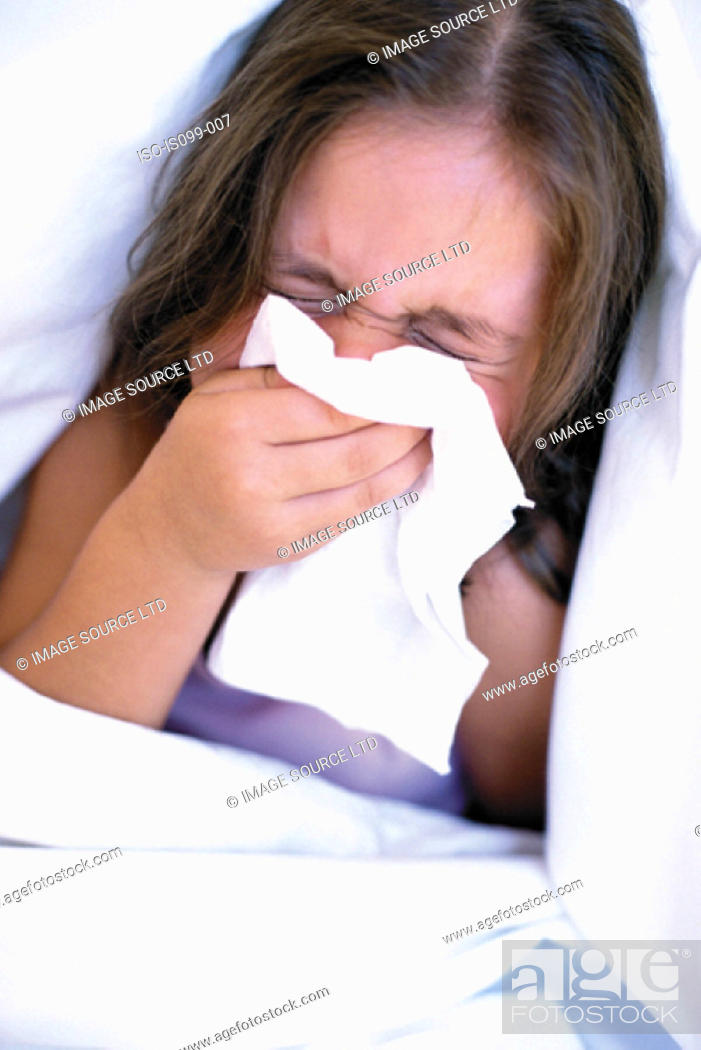 Stock Photo: Girl blowing nose.