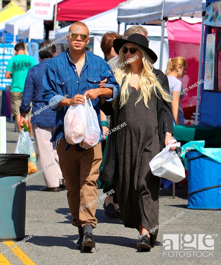 Stock Photo: Heavily pregnant Ashlee Simpson buys fresh salsa, strawberries and a jumbo sausage sandwich together with a watermelon drink at the Studio City Farmers Market.