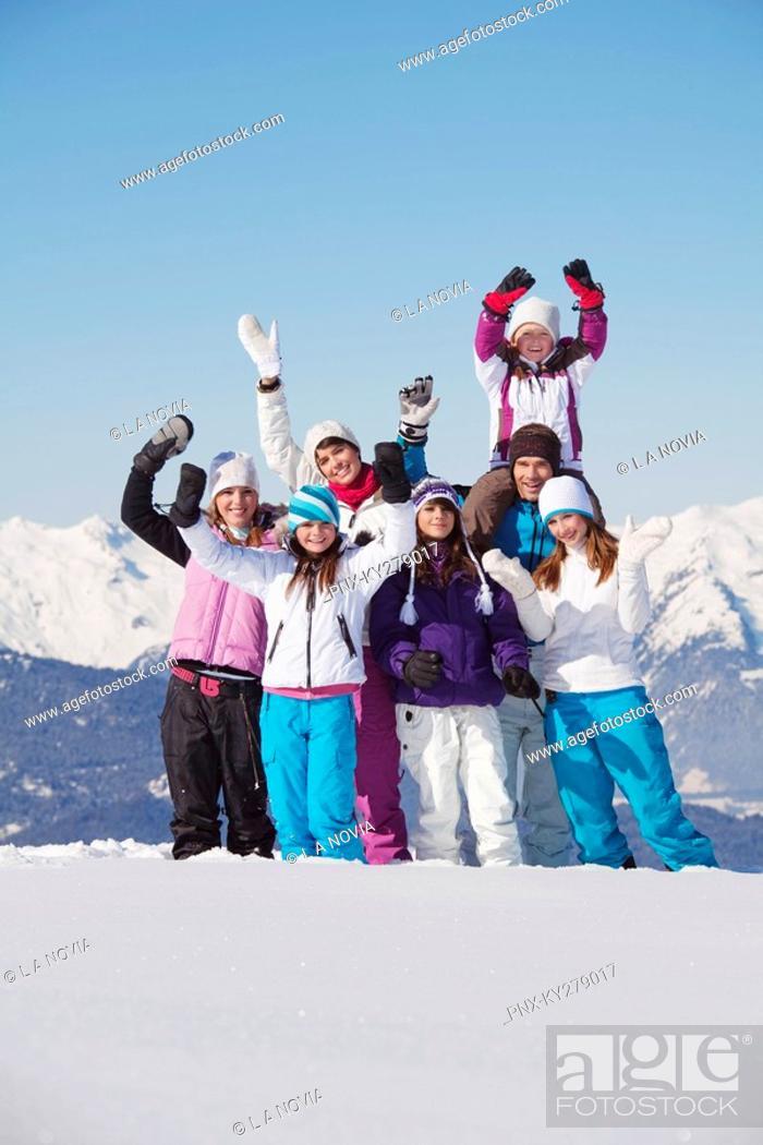 Stock Photo: Happy family in snow.