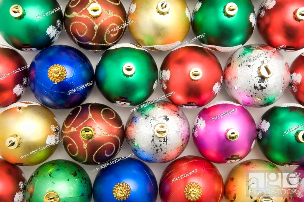 Stock Photo: Rows of colorful Christmas baubles.