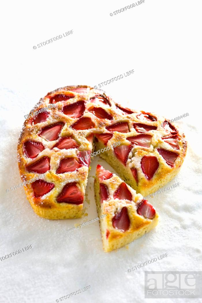 Stock Photo: A heart-shaped cake with strawberries and lemongrass.