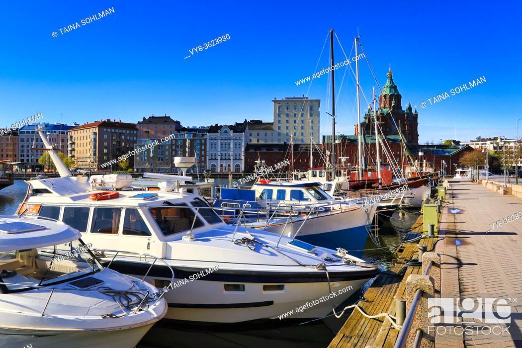 Stock Photo: Pohjoisranta promenade on sunny morning with recreational boats and Katajanokka with Uspenski Cathedral in the background. Helsinki, Finland. May 2020.