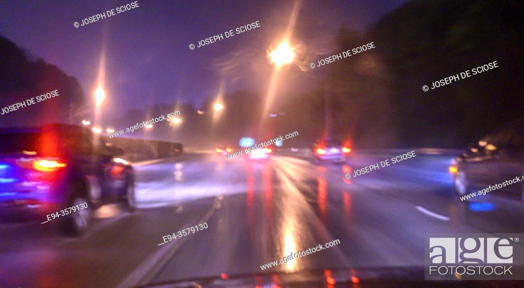 Stock Photo: Traffic scene on a rainy night.
