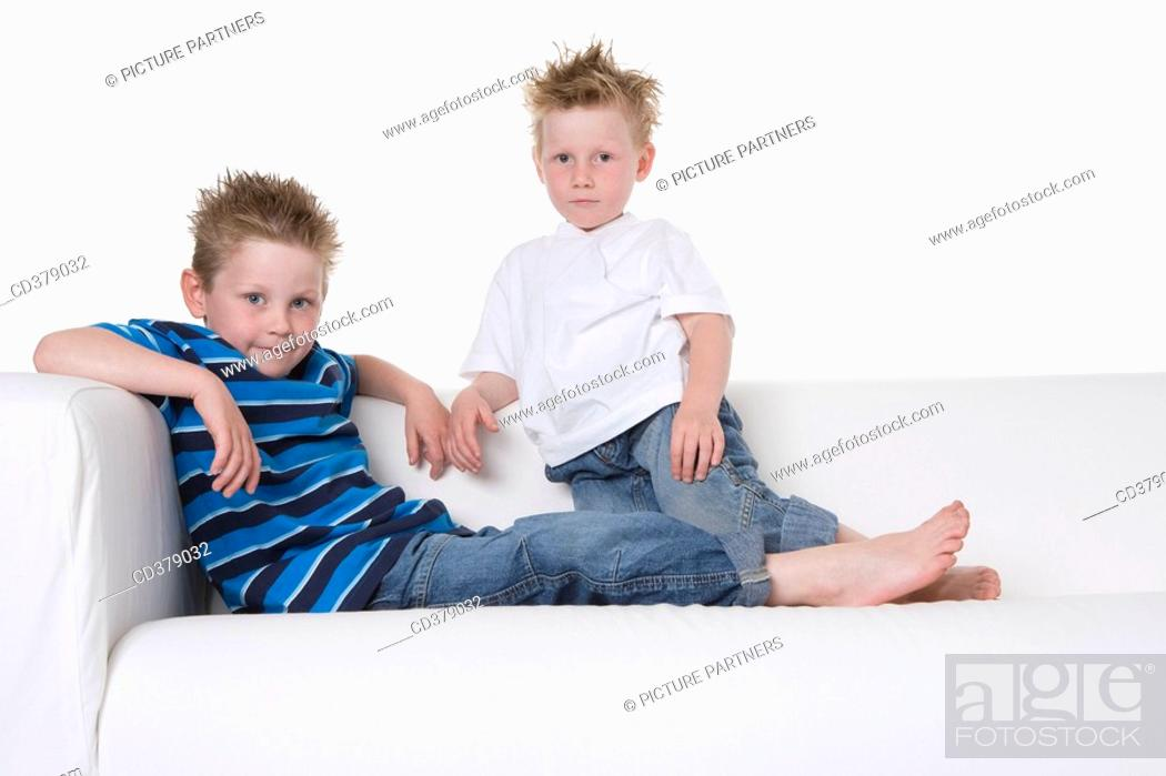 Stock Photo: Two boys sitting on a bench.