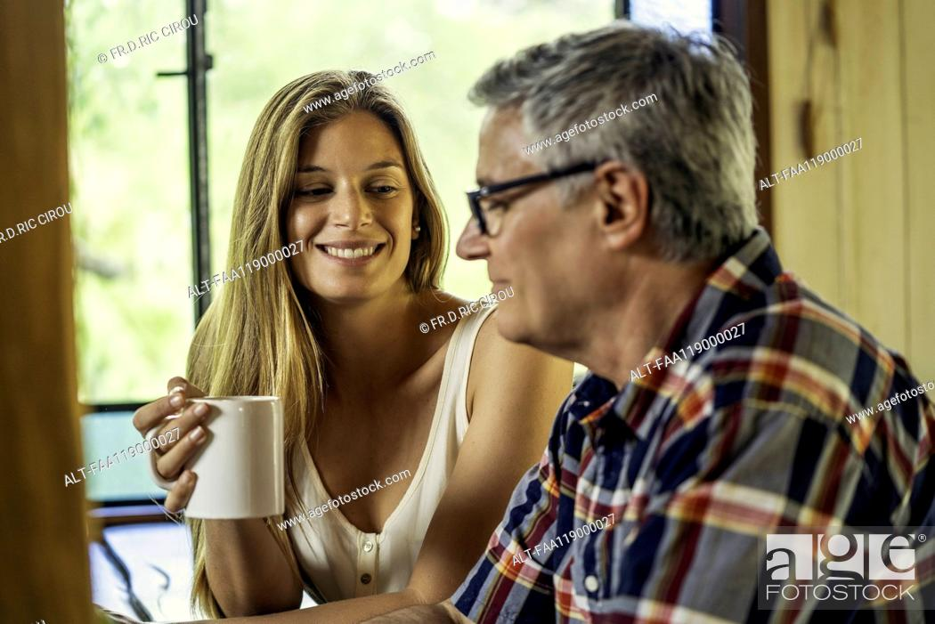 Stock Photo: Woman talking with her father.