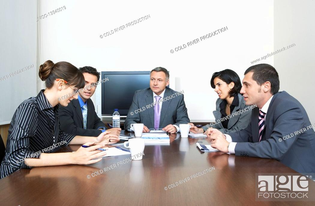 Stock Photo: Businesspeople having meeting in office.