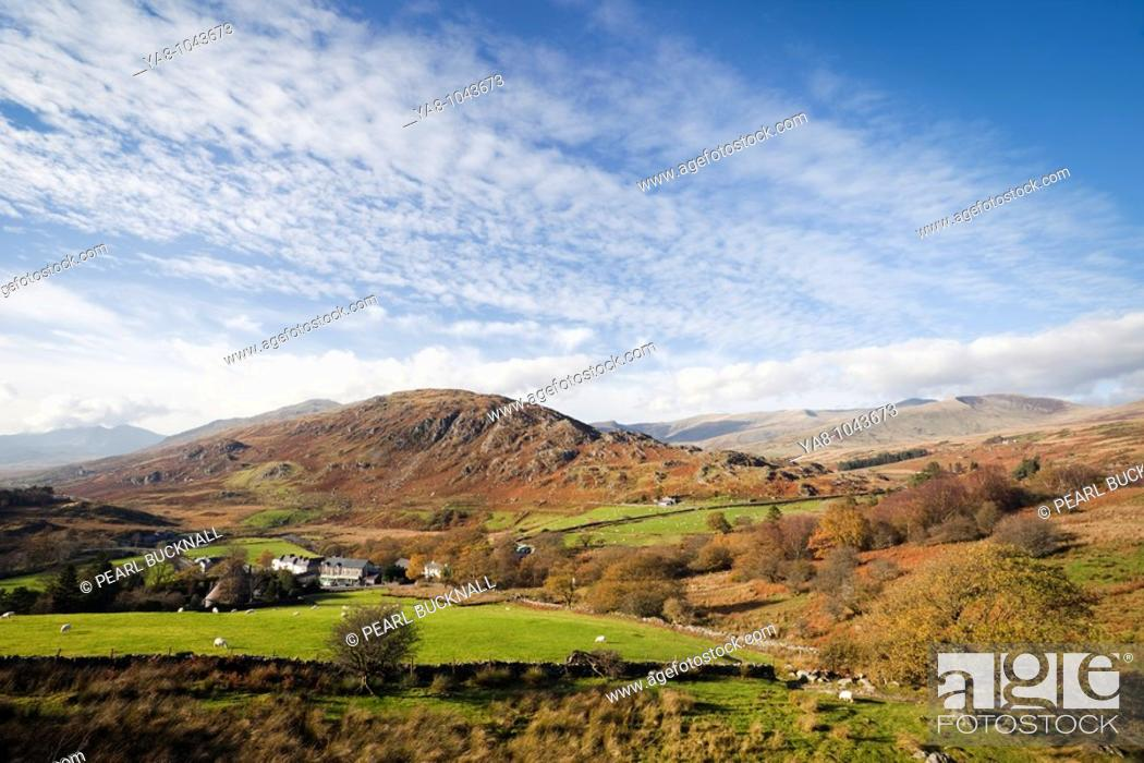 Stock Photo: Capel Curig Conwy North Wales UK Europe  View above the village to Cefn y Capel and distant mountains in Snowdonia National Park in autumn.