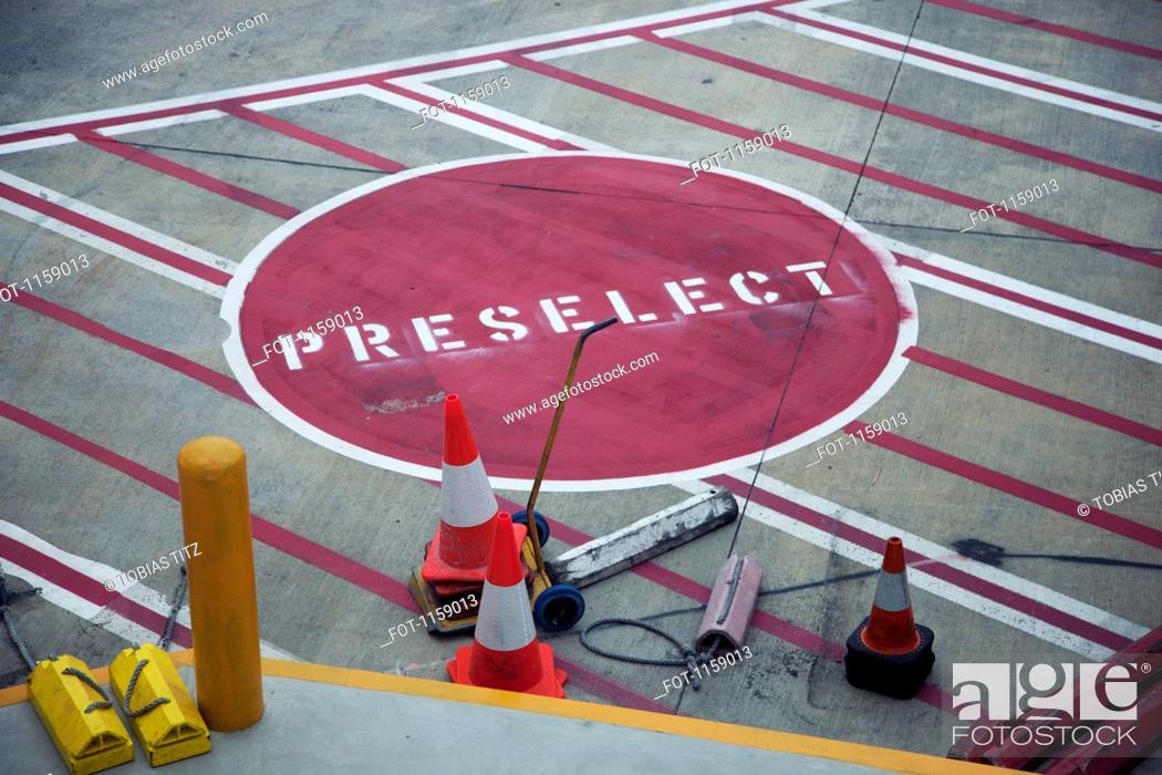 Stock Photo: Road Marking 'Preselect' on airport runway.