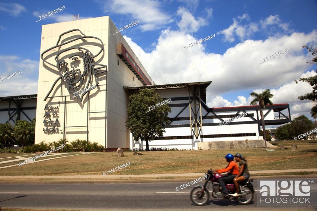Stock Photo: Motorcyclist in front of the Convention Center Heredia-Centro De Convenciones Heredia in the city center, Santiago De Cuba, West Indies, Central America.