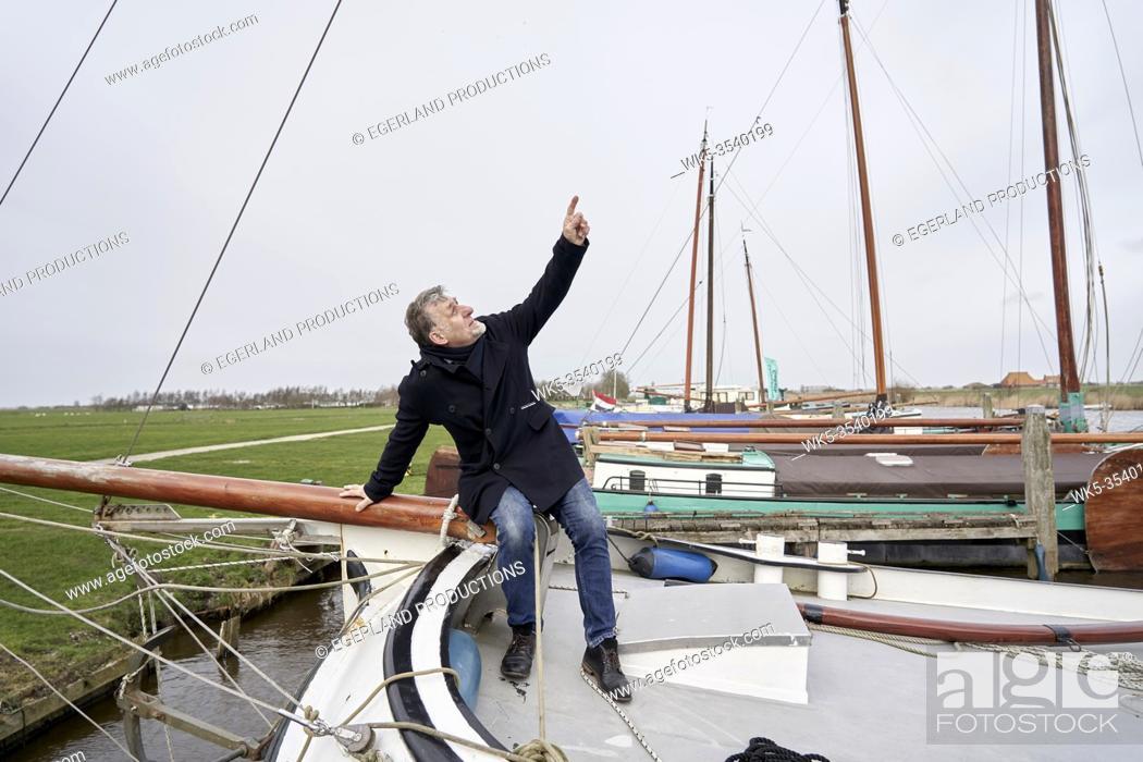Stock Photo: senior man on sailing ship in Friesland, Netherlands.