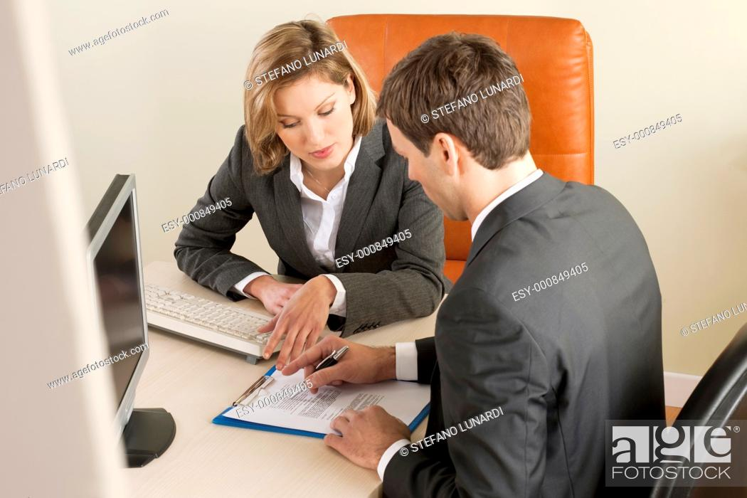 Stock Photo: Businesspeole working in the office.