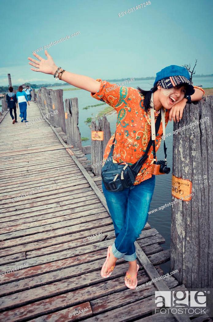 Stock Photo: Thai women travel on U Bein Wooden longest Bridge in Amarapura, Myanmar.