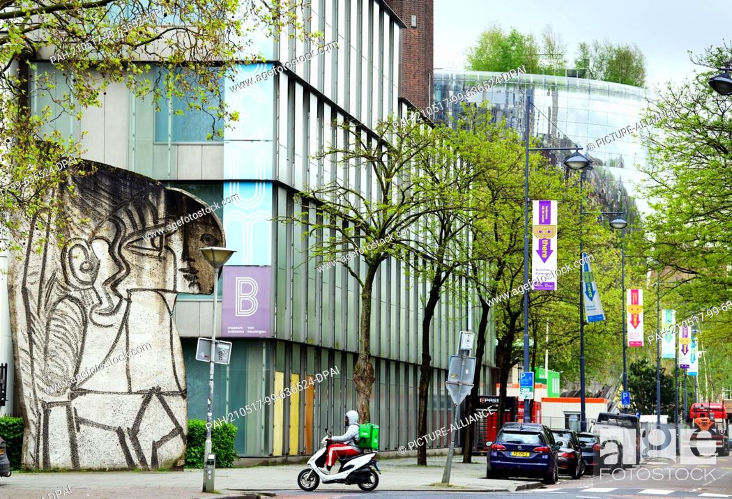 """Stock Photo: 17 May 2021, Netherlands, Rotterdam: The stone sculpture """"""""Sylvette"""""""" by Pablo Picasso stands in front of the Museum Boijmans Van Beuningen."""