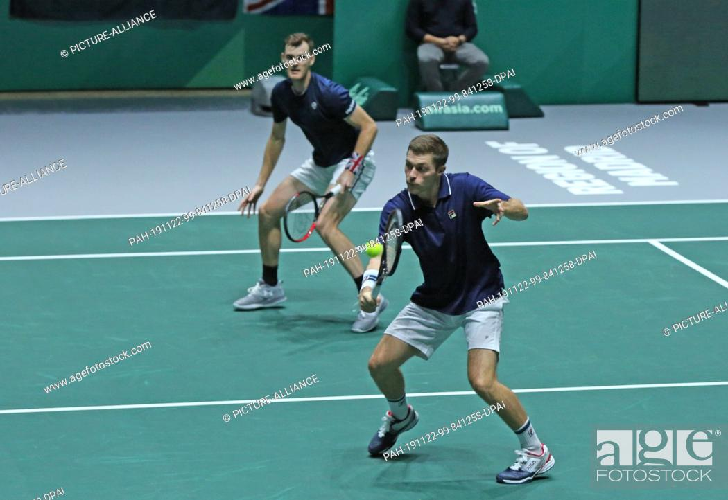Stock Photo: 21 November 2019, Spain, Madrid: The tennis players of Great Britain doubles team Jamie Murray and Neal Skupski play versus Kazakhistan.