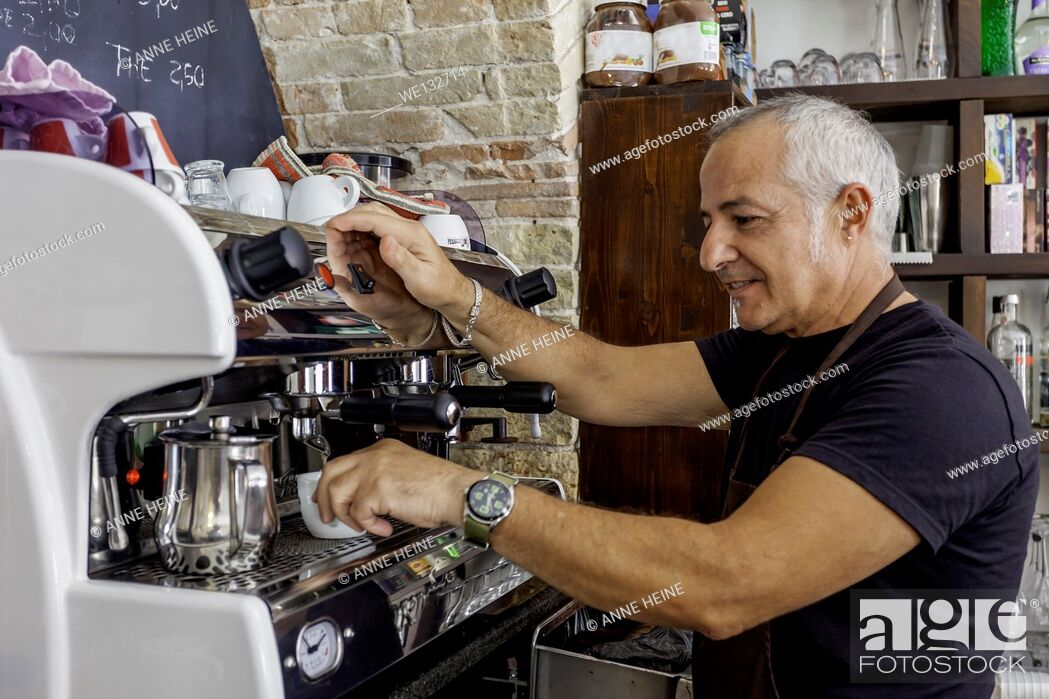 Stock Photo: Waiter waiting at espresso machine in an old cafe in Cagliari, Sardinia,Italy.