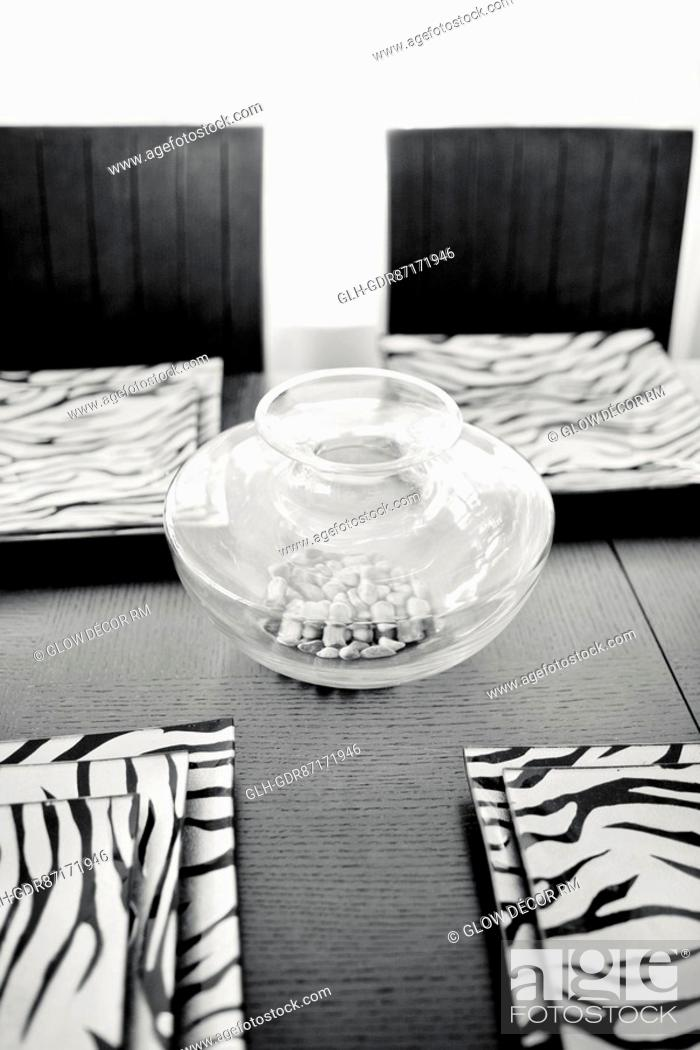 Photo de stock: Trays and showpiece on a dining table.