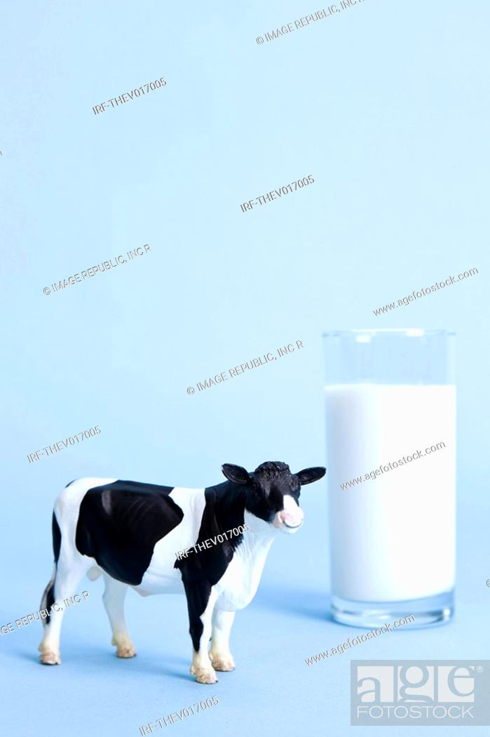 Stock Photo: glass of milk and animal shape, cow.