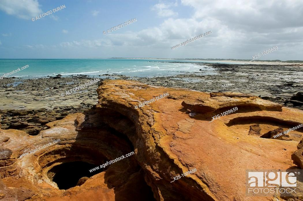 Stock Photo: Red and black rocks at the shore, Gantheaume Point, Broome, Western Australia, Australia.