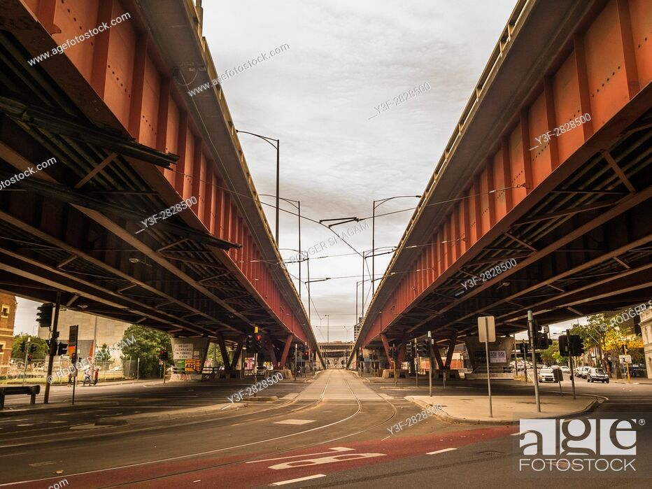 Stock Photo: Overhead traffic to help rush-hour flow, with tram tracks in the foreground.