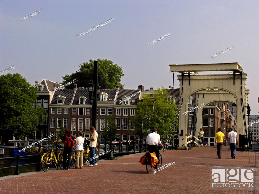 Stock Photo: people at the Magere Brug at the Amstel in Amsterdam, Netherlands.