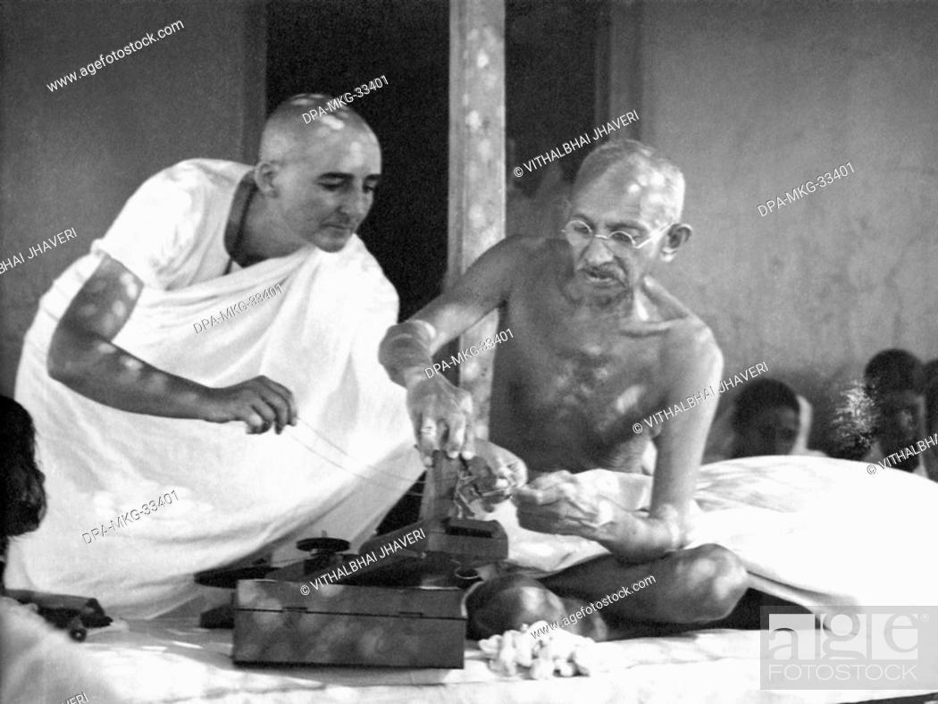 Mahatma Gandhi repairing his charkha (spinning wheel