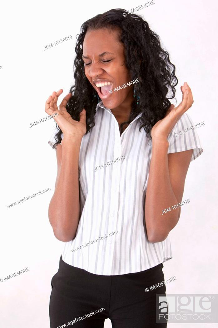 Stock Photo: Young woman shouting with eyes closed.