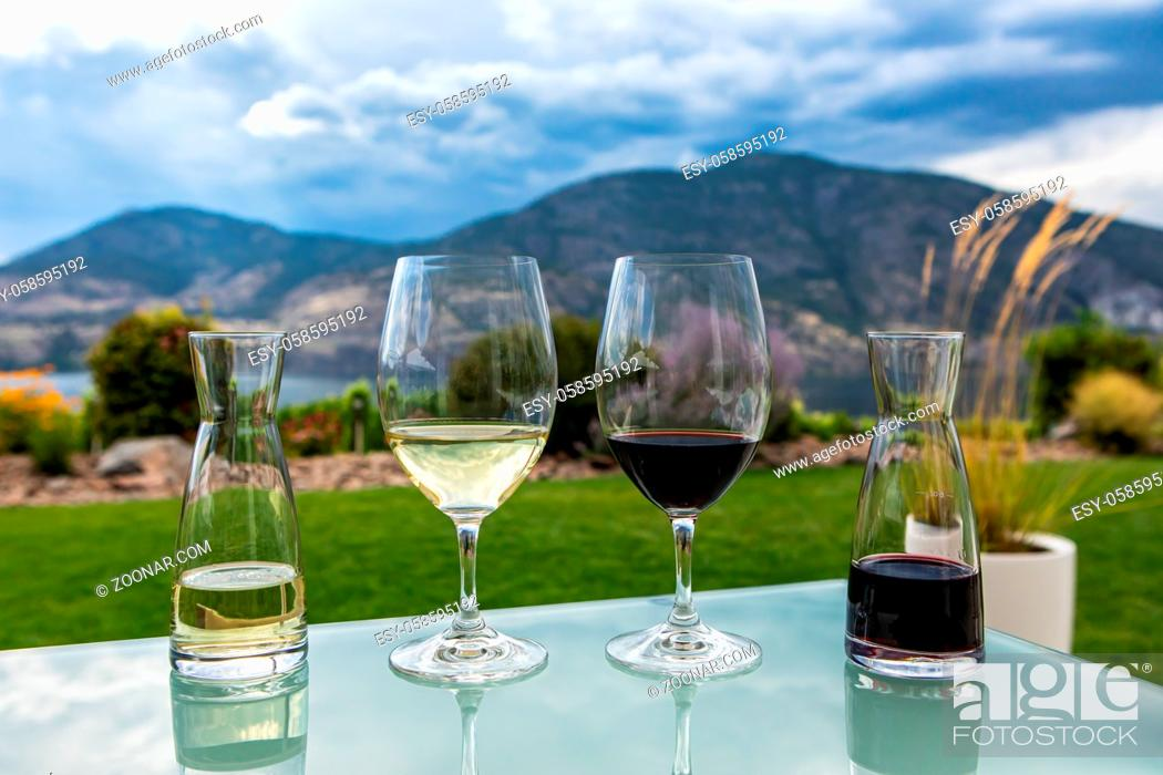 Stock Photo: mini decanters and wine glasses filled with red and white wines selective focus, Canadian Okanagan Lake, Valley region, British Columbia BC Canada.