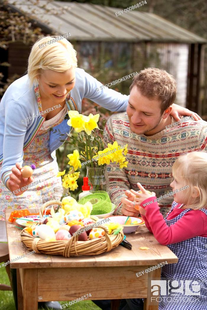 Stock Photo: Family Decorating Easter Eggs On Table Outdoors.