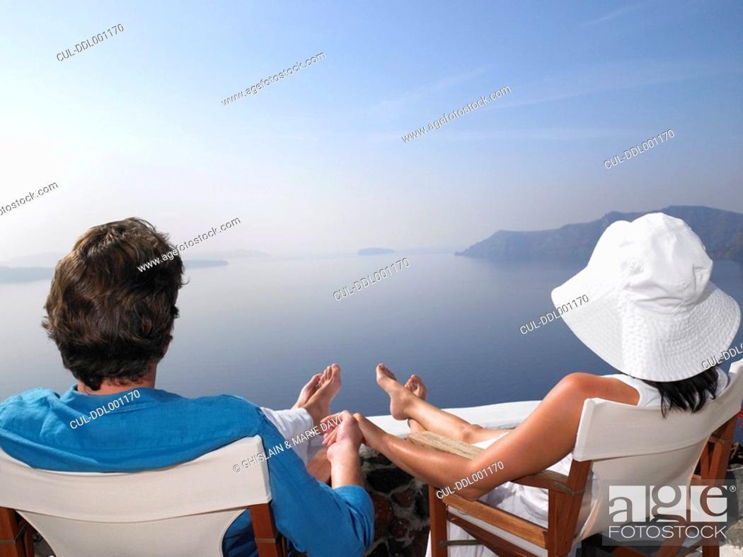 Stock Photo: Couple sitting on a sundeck.