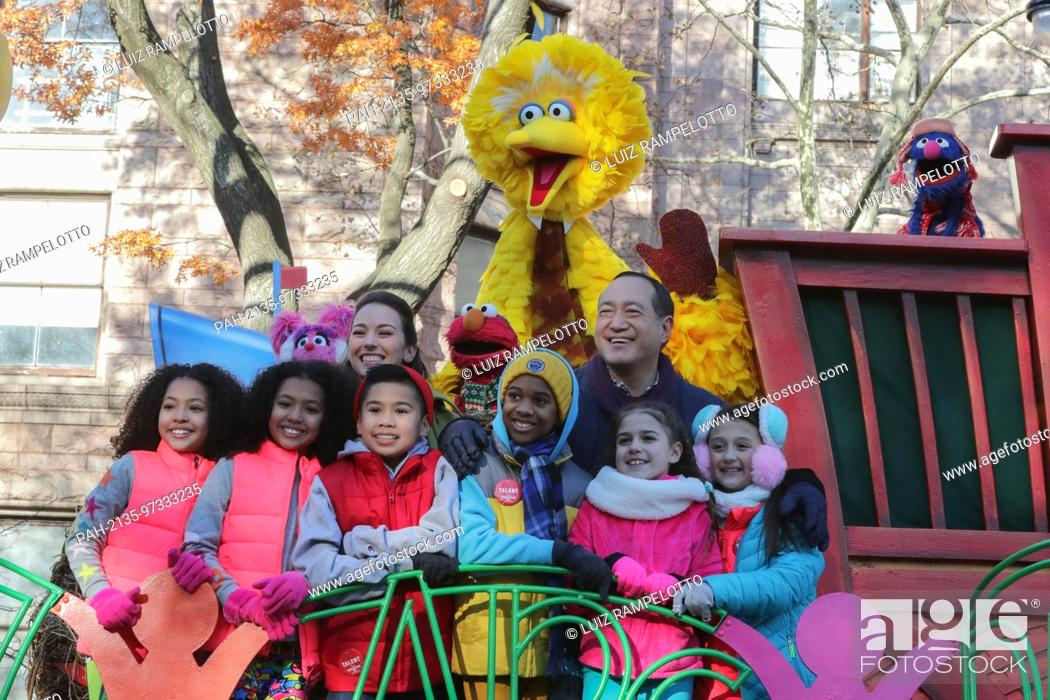 Stock Photo: Central Park West, New York, USA, November 23 2017 - Sesame Street Performers attends the 91st Annual Macy's Thanksgiving Day Parade today in New York City.