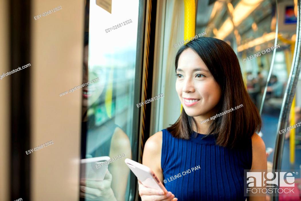 Stock Photo: Woman using mobile phone.