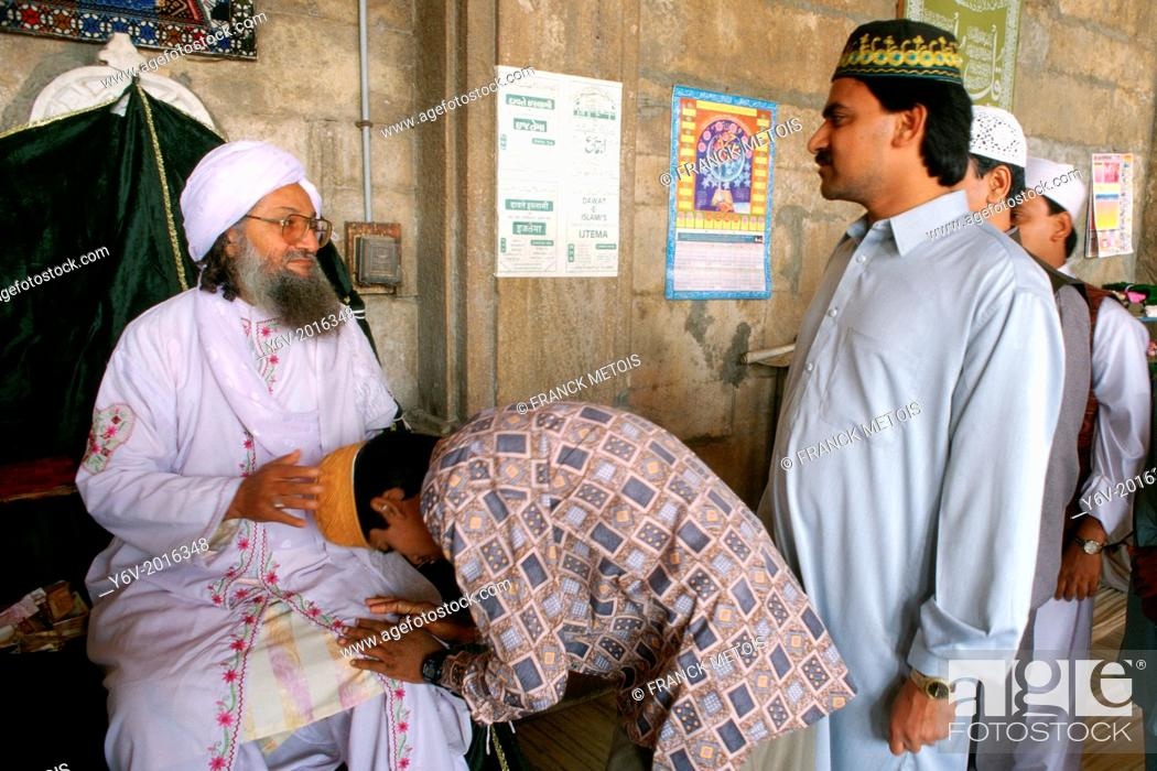 Stock Photo: Muslim men paying homage to a sufi leader. Ajmer, India.