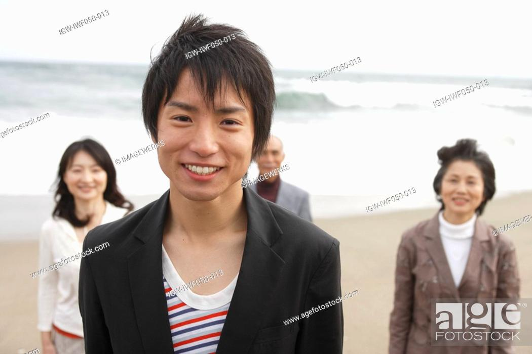 Stock Photo: Family at beach, smiling, portrait.