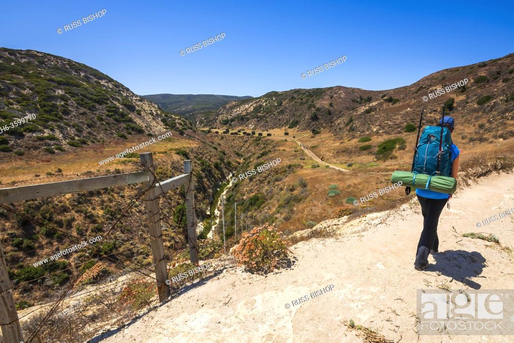 Stock Photo: Hiker at Water Canyon, Santa Rosa Island, Channel Islands National Park, California USA.