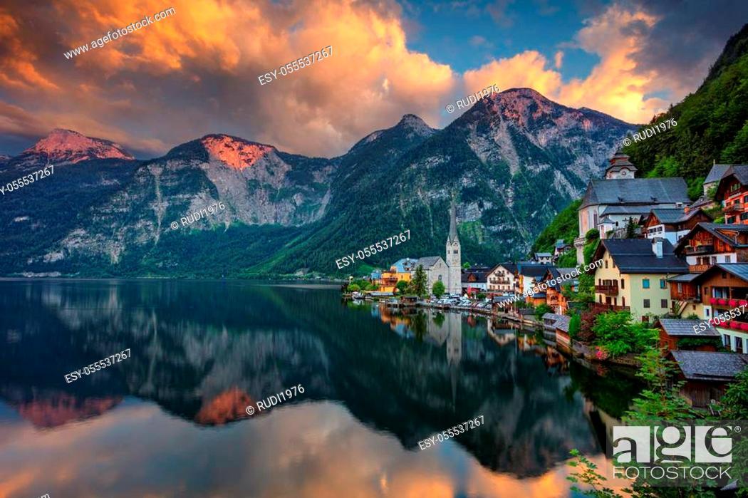 Stock Photo: Image of famous alpine village Hallstatt at dramatic summer sunset.