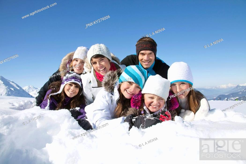 Stock Photo: Happy family lying in snow.