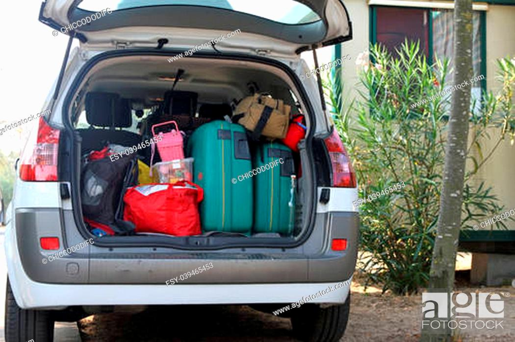 Stock Photo: Car full of suitcases and bags before leaving for summer vacation.