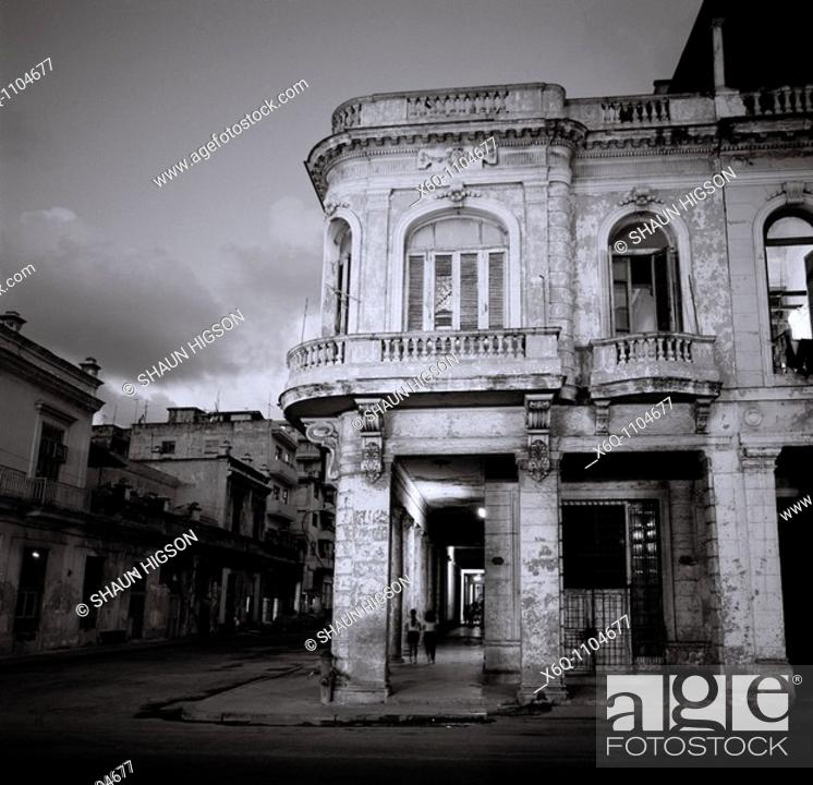 Stock Photo: A night picture of a street corner off the Paseo del Prado in Havana, Cuba.