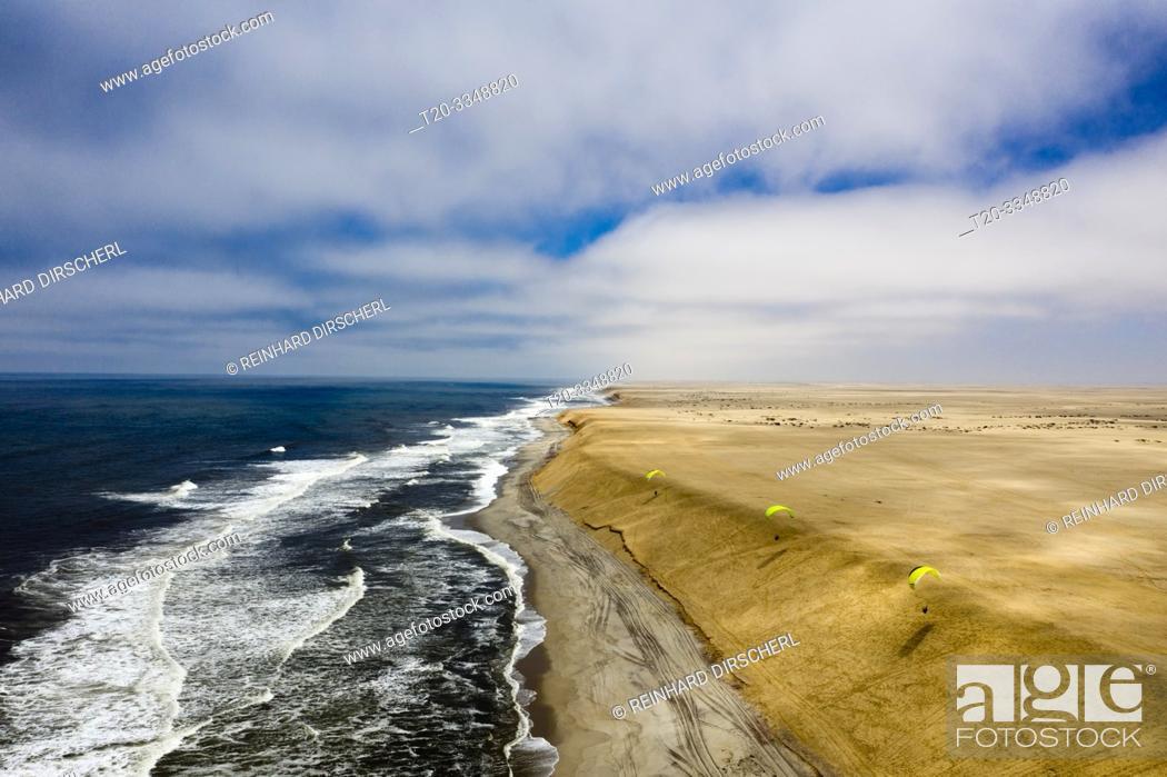 Stock Photo: Paragliding at Dune near Henties Bay, Henties Bay, Namibia.