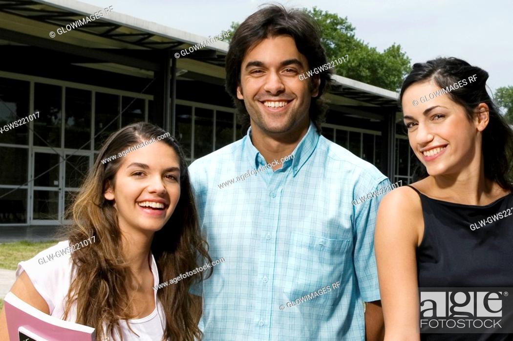 Stock Photo: Portrait of three university students smiling.