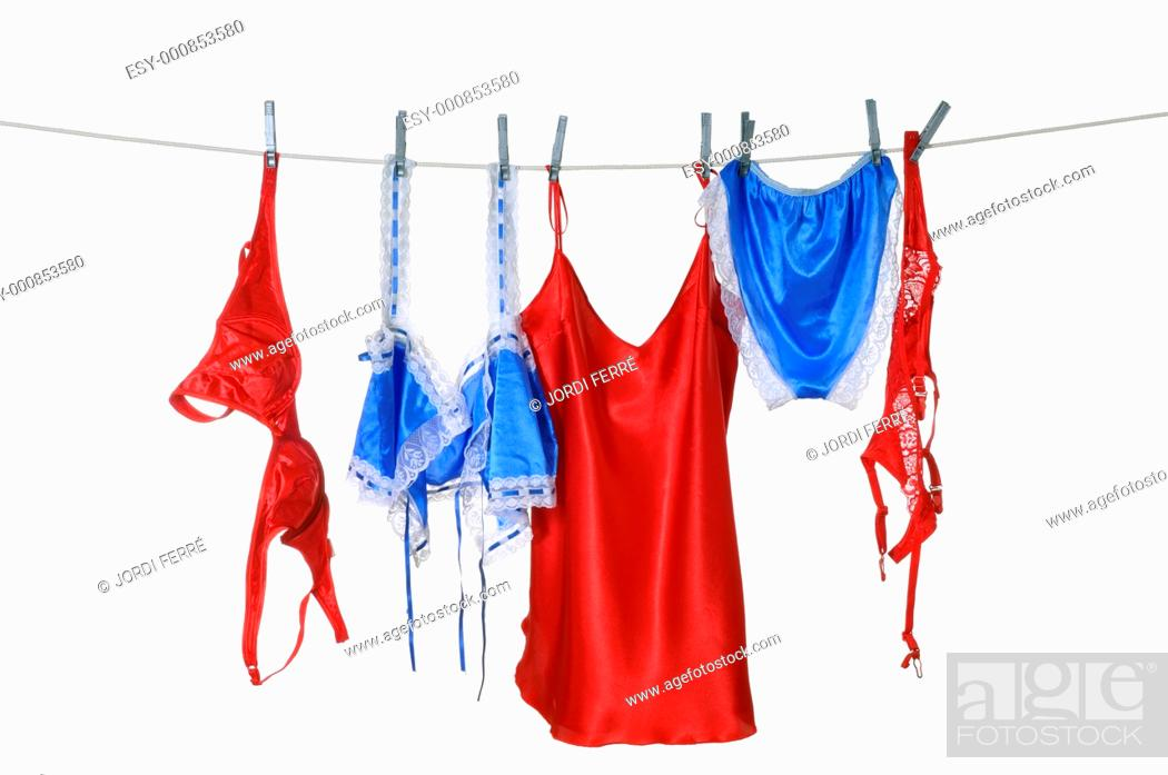 Stock Photo: Blue and red lingerie hanging.