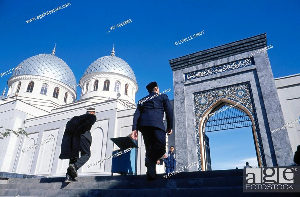Stock Photo: Men going to the mosque, Tashkent, Uzbekistan.