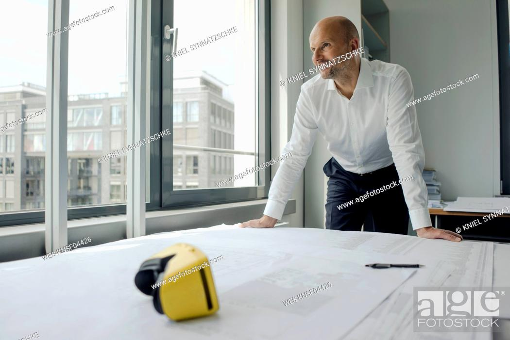 Stock Photo: Engineer working in his office, with VR glasses on his desk.