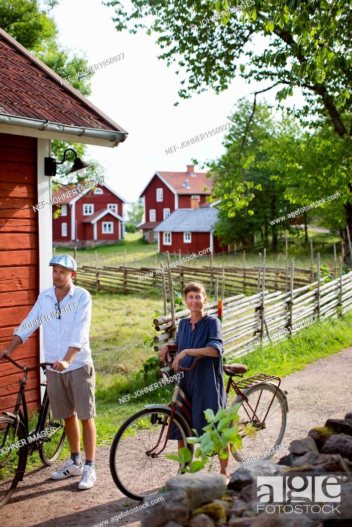 Stock Photo: Mature couple cycling, Smaland, Sweden.