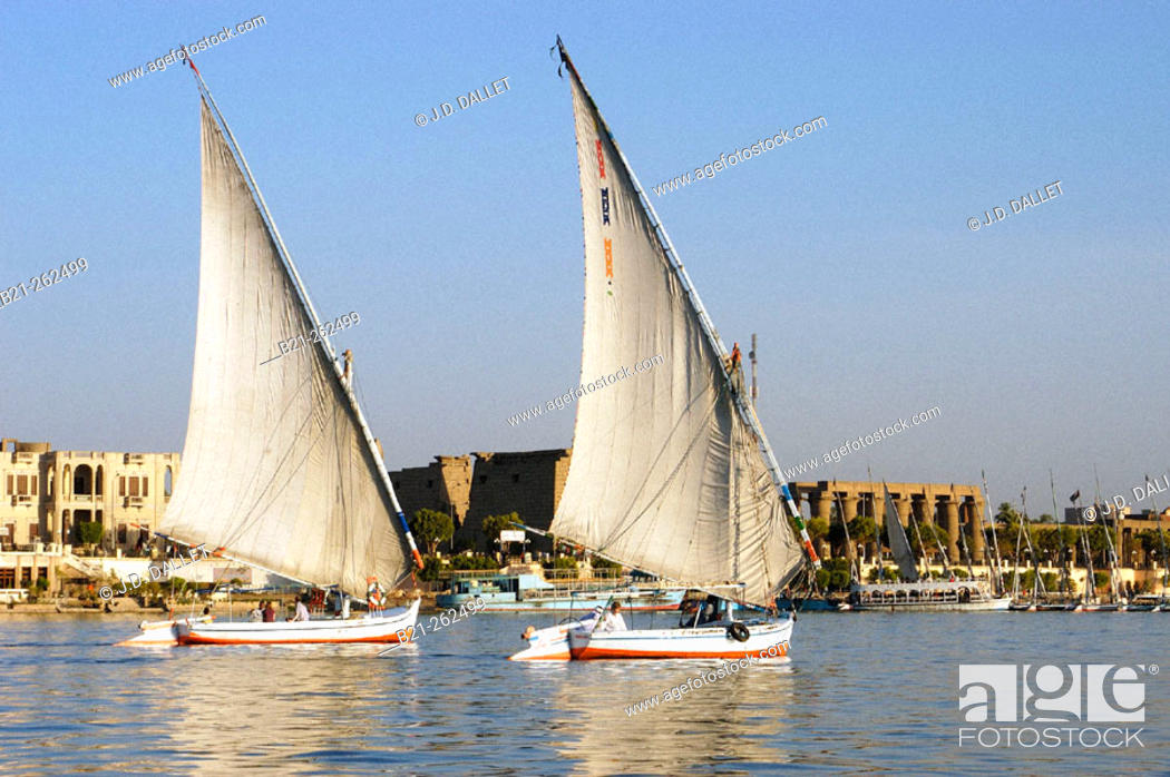 Stock Photo: Feluccas on Nile River and Luxor temple in background. Egypt.