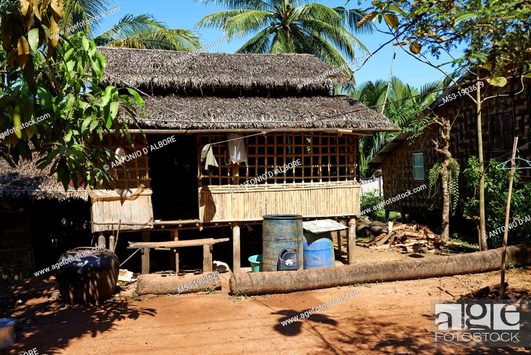 Stock Photo: An home made of wood, bamboo and dried palm leaves  Parda Gyi village  Myanmar.