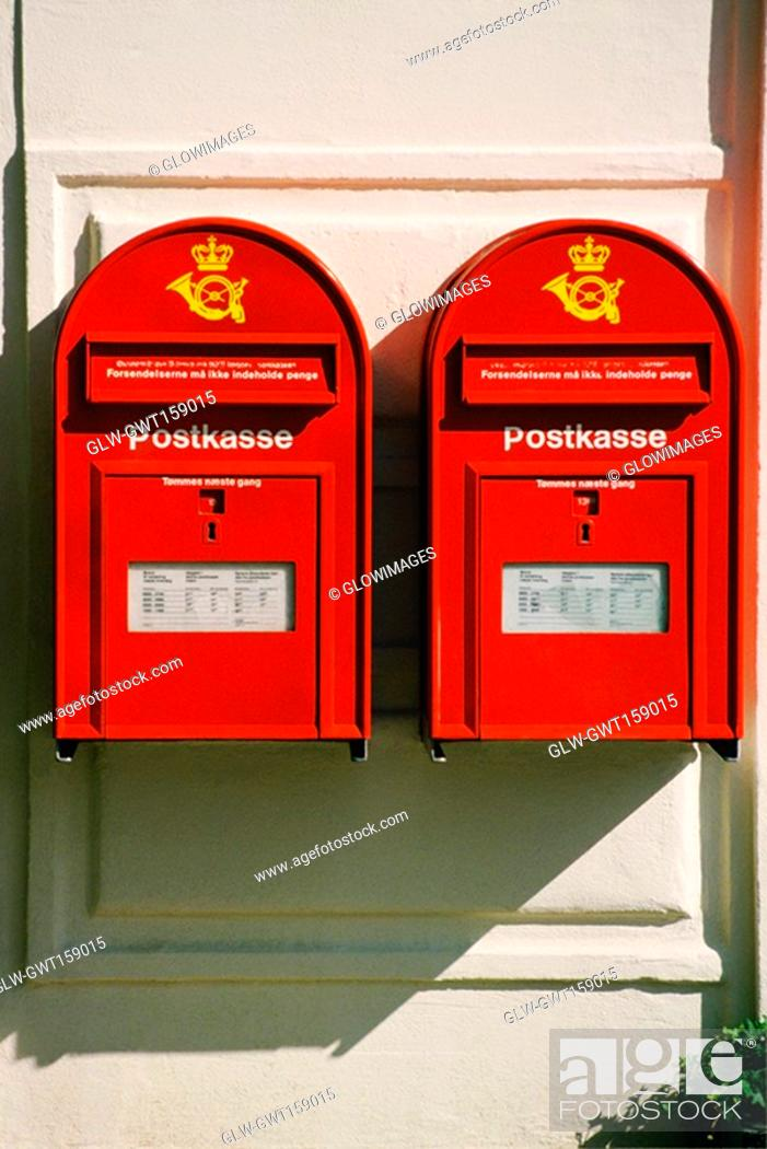 Stock Photo: Close-up of two mailboxes on the wall, Copenhagen, Denmark.