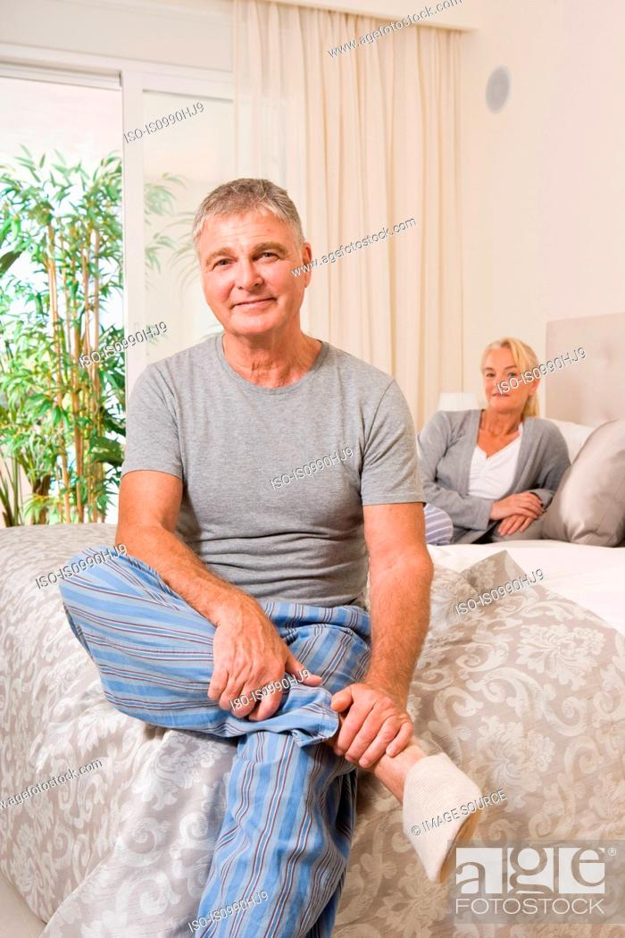 Stock Photo: Mature couple in bedroom.
