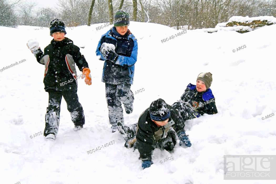 Stock Photo: Boys in snow Baden-Wurttemberg Germany cap snowball fight snow suit.
