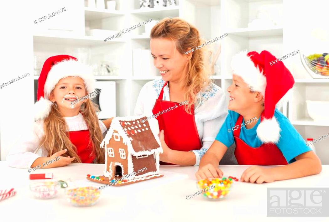 Stock Photo: Santa came earlier this year - family having fun in the kitchen.